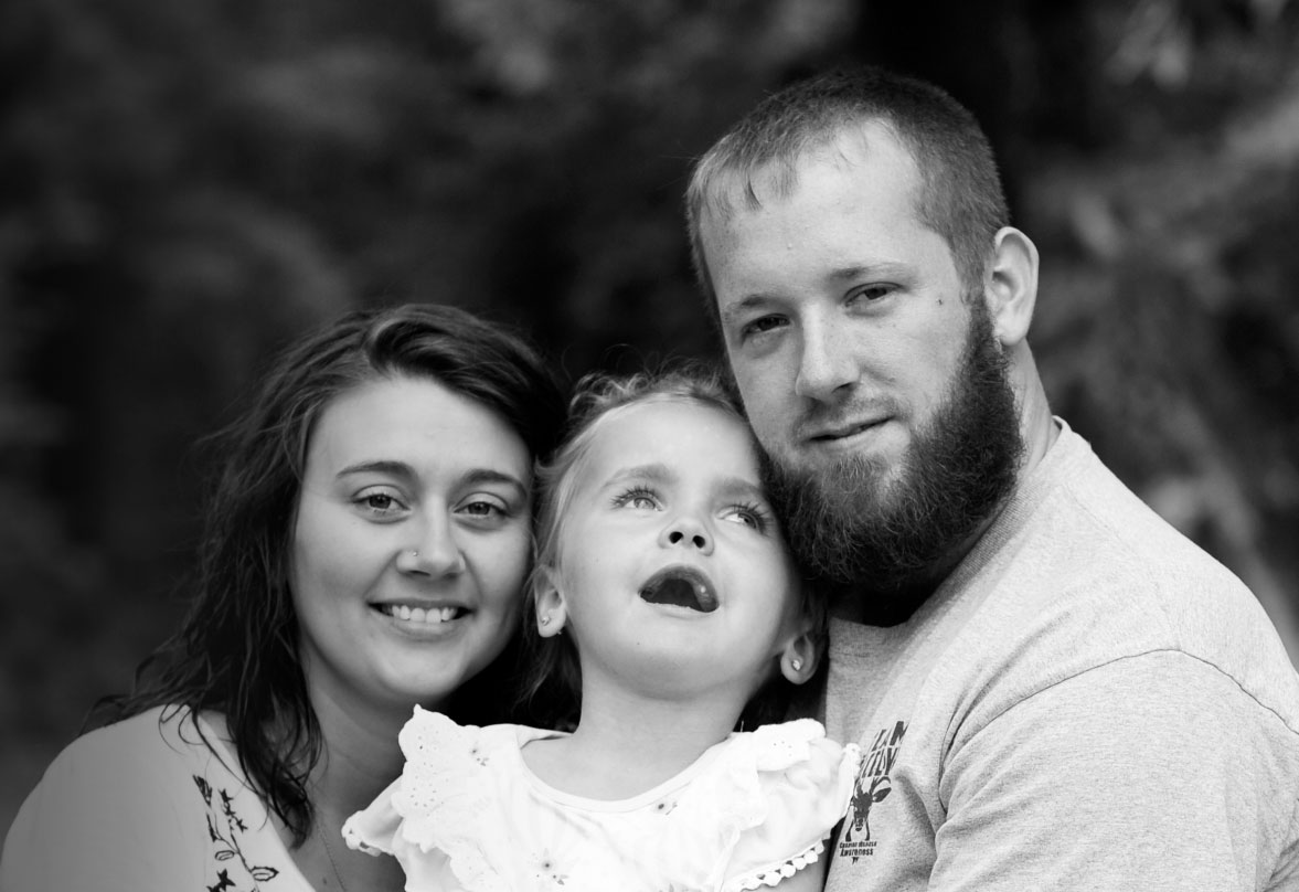 Black and white photo of family with daughter with Canavan disease