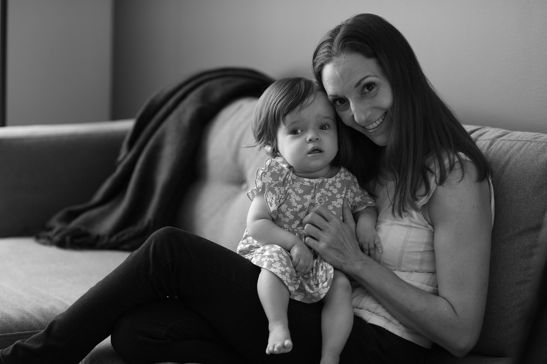 Black and white photo of mother holding infant daughter with Canavan disease